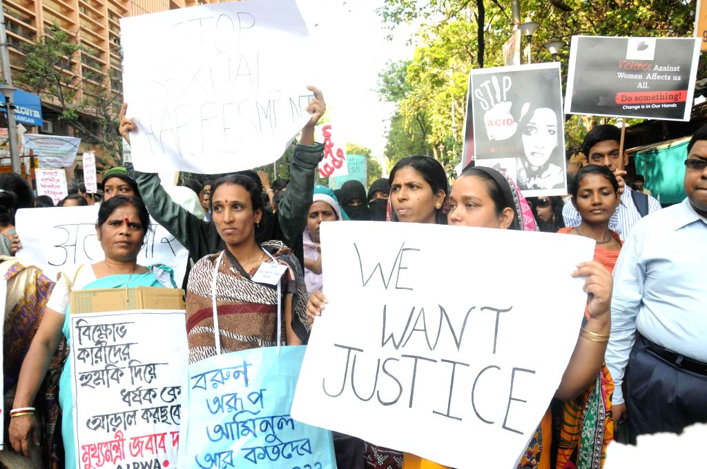 Women stage a demonstration to protest against crime against women in Kolkata, on March 19, 2015.