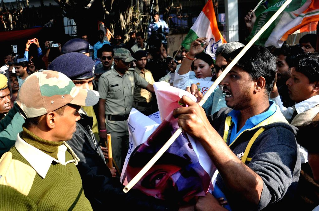 Youth Congress activists take part in a protest rally against West Bengal Government in front of CGO Complex in Kolkata Dec 29, 2014.