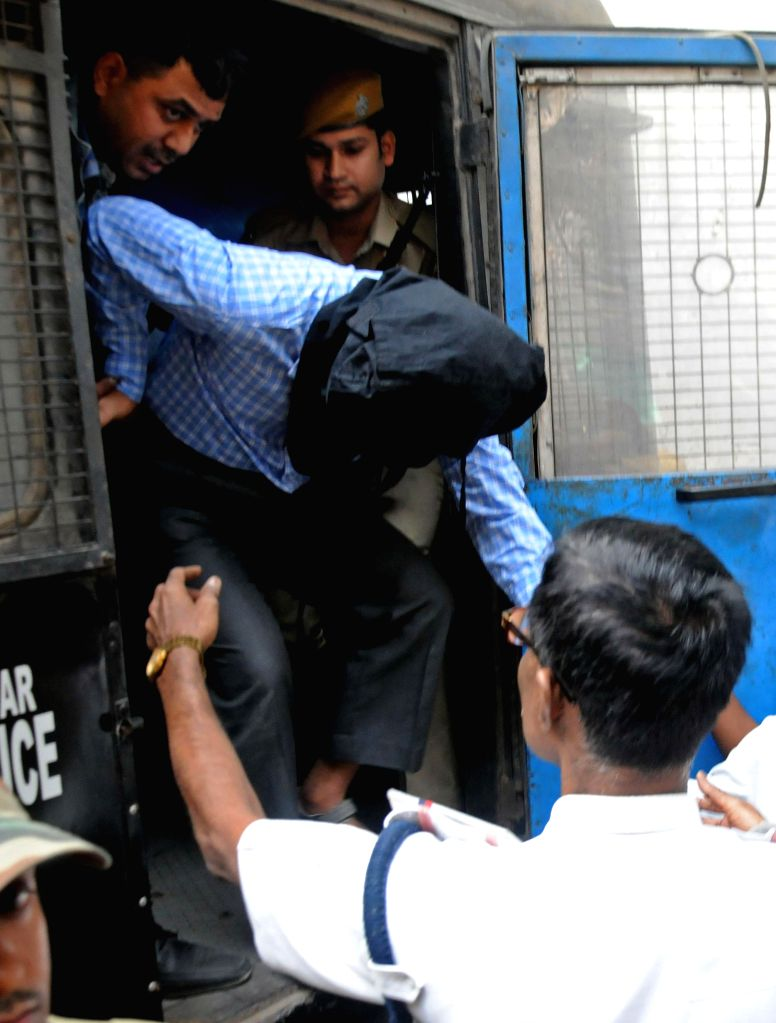 Zia-Ul-Haq accused in Burdwan blast case being produce at local court by NIA official in Kolkata on Nov 20, 2014.