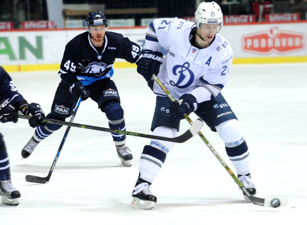 Konstantin Gorovikov of Dynamo Moscow (R) drives the puck during Kontinental Hockey League (KHL) match against Medvescak Zagreb in Zagreb, capital of Croatia, Jan. ...