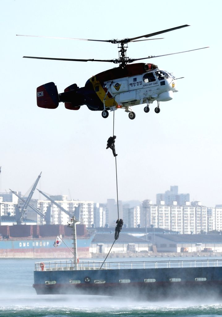 Korea Coast Guard special forces rappel from a helicopter onto a ferry in waters off the city of Incheon, west of Seoul, on Nov. 1, 2018, as the maritime police take part in a drill simulating ...