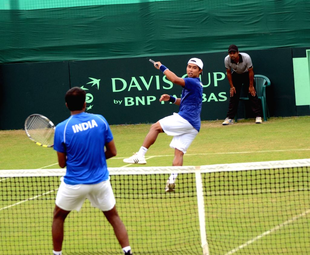 Korea's Hong Chung in action against India's Rohan Bopanna during Asia/Oceania Group I 2nd Round of Davis Cup in Chandigarh on July 17, 2016. - Rohan Bopanna