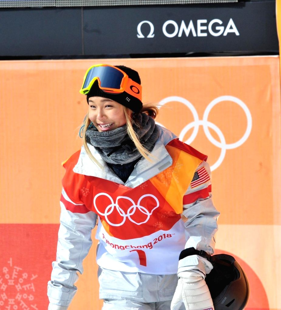Korean-American snowboarder Chloe Kim, the world's No. 1 snowboarder, reacts after crossing the finish line in a women's halfpipe preliminary at the PyeongChang Winter Olympics at ...