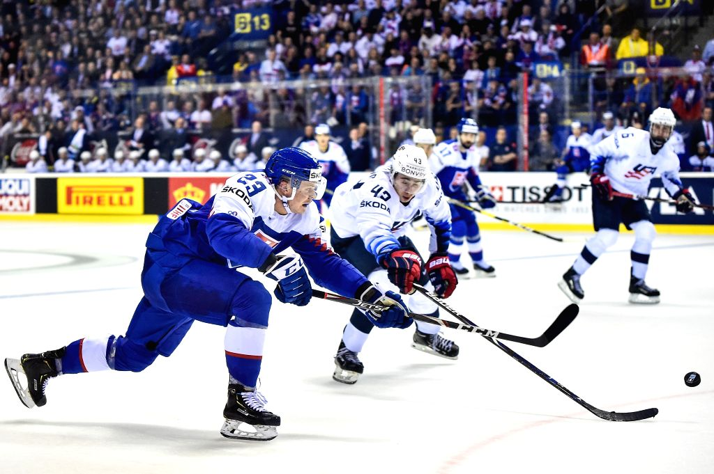 KOSICE, May 11, 2019 - Quinn Hughes (front R) of the United States tackles Adam Liska (front L) of Slovakia during the 2019 IIHF Ice Hockey World Championship group A game between the United States ...