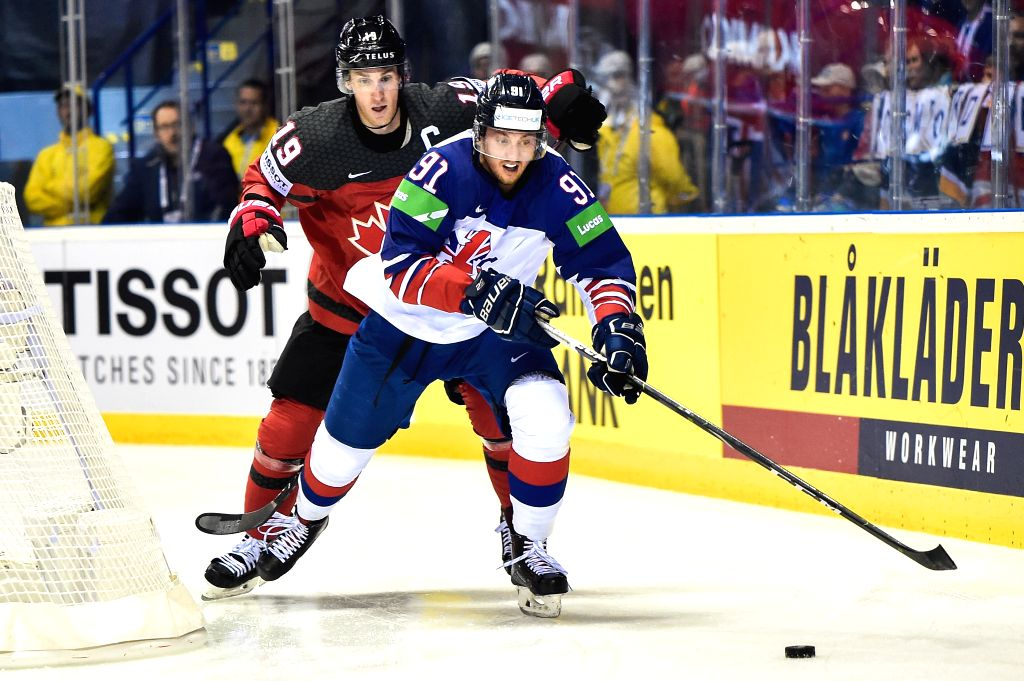 KOSICE, May 13, 2019 - Kyle Turris (L) of Canada vies with Ben Lake of Great Britain during the 2019 IIHF Ice Hockey World Championship Slovakia group A game between Great Britain and Canada at Steel ...
