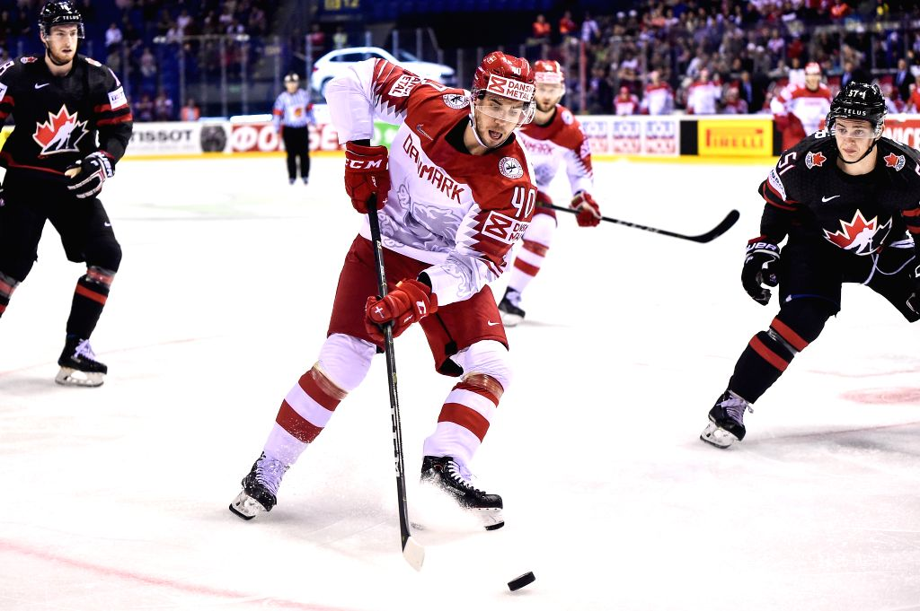 KOSICE, May 21, 2019 - Jesper Jensen (C, front) of Denmark passes the puck during the 2019 IIHF Ice Hockey World Championship Slovakia group A game between Canada and Denmark at Steel Arena in ...