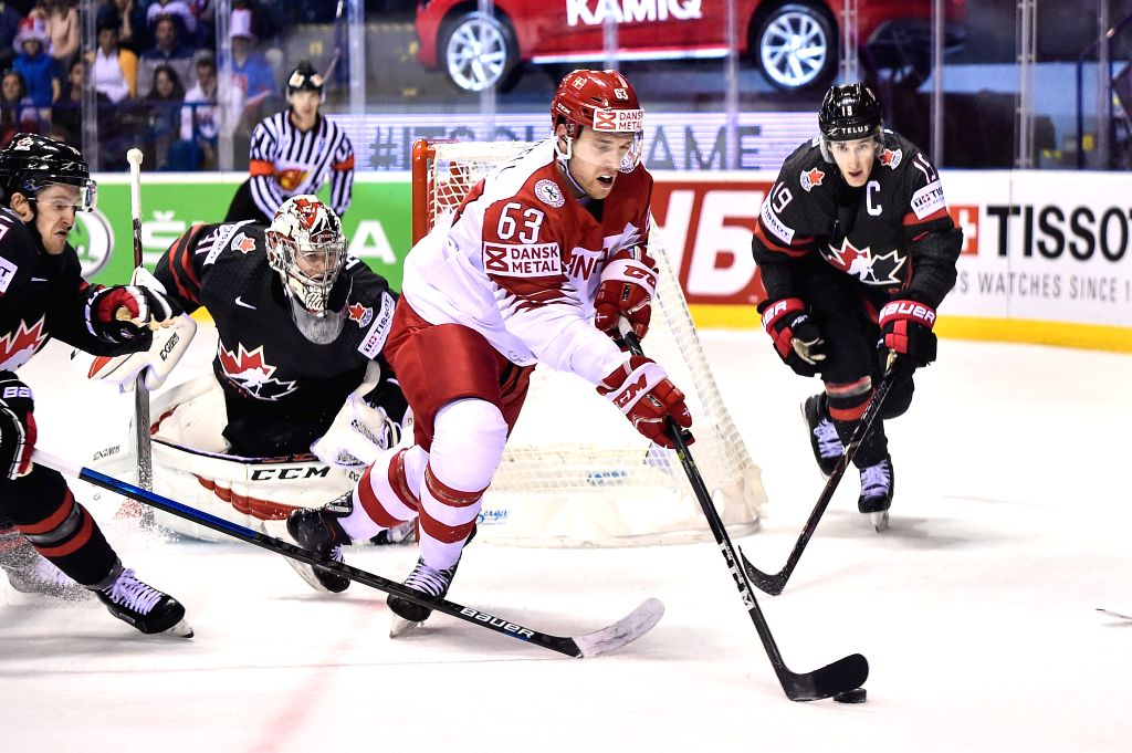 KOSICE, May 21, 2019 - Kyle Turris (1st R) of Canada tackles Patrick Russell (2nd R) of Denmark during the 2019 IIHF Ice Hockey World Championship Slovakia group A game between Canada and Denmark at ...