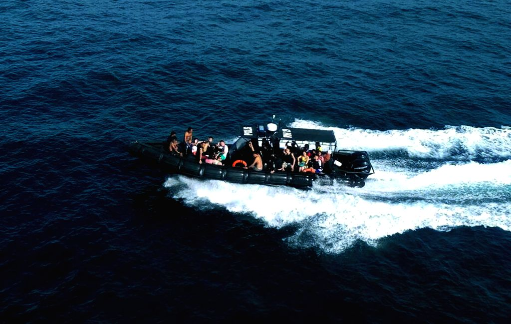KOTA KINABALU, June 24, 2016 - Rescued people are transferred to safe place in Kota Kinabalu, Malaysia, June 24, 2016. Malaysian authorities rescued 22 people, including 12 Chinese tourists on Friday ...