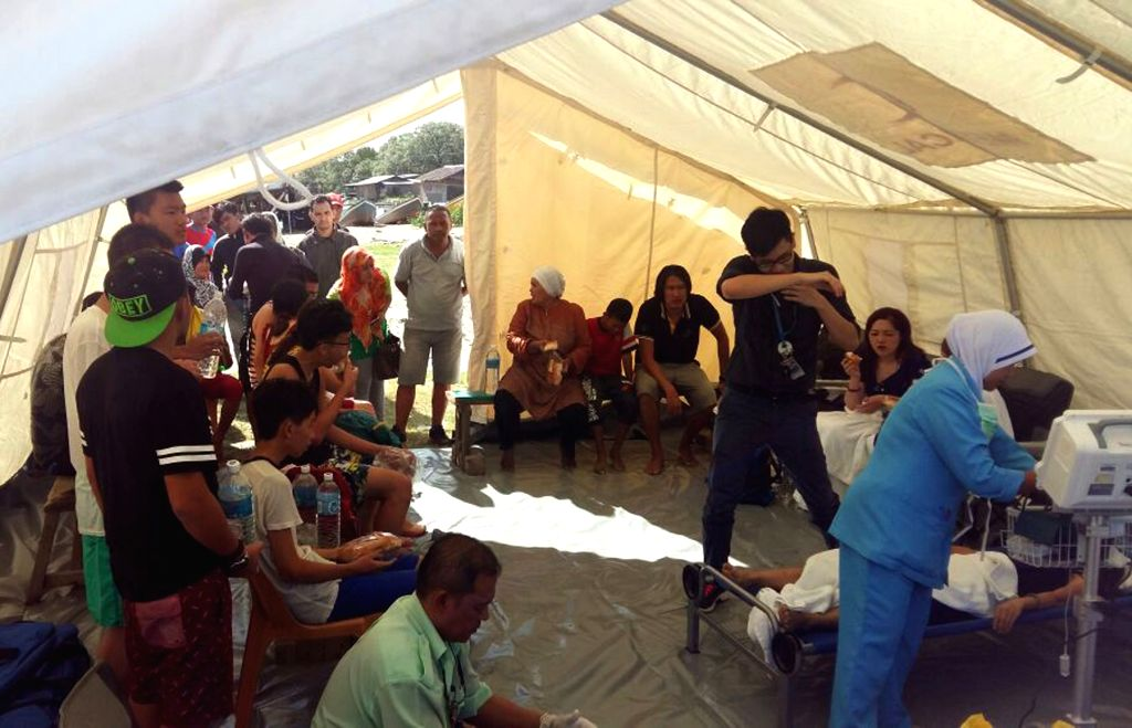 KOTA KINABALU, June 24, 2016 - Rescued people take a rest in Kota Kinabalu, Malaysia, June 24, 2016. Malaysian authorities rescued 22 people, including 12 Chinese tourists on Friday who were stranded ...