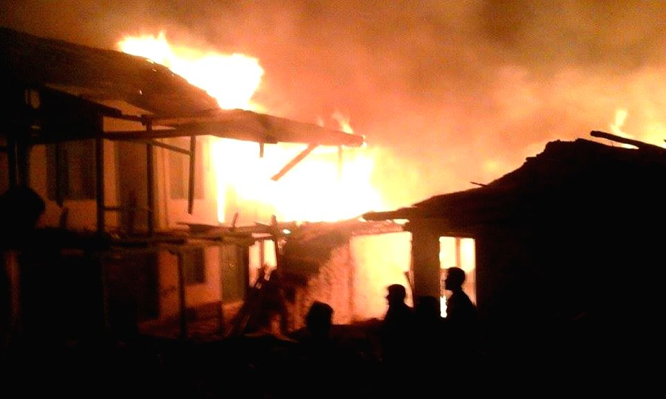 :Kotla: Fire broke out at Kotla village in Banjar subdivision of Kullu district where more than 50 houses and an ancient temple were gutted on Nov 15, 2015. (Photo: IANS).