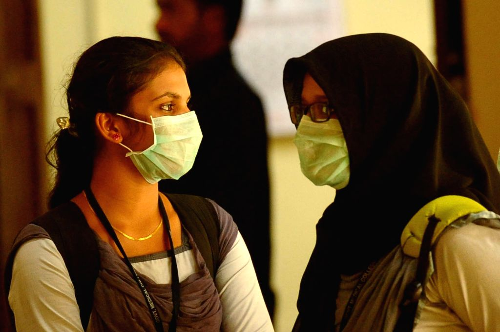 Kozhikode (Kerala): Students wear safety masks as a precautionary measure after the outbreak of 'Nipah' virus in Kozhikode, Kerala on May 22, 2018.