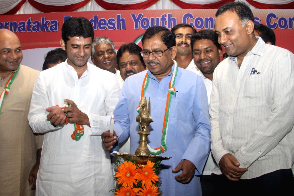 KPCC President G Parmeshwar wtth Minister for Food and Civil Supplies Dinesh Gundu Rao, President Youth Congress Rizwan Arshad and other congress leaders lighting the lamp to inaugurate the 55th ...
