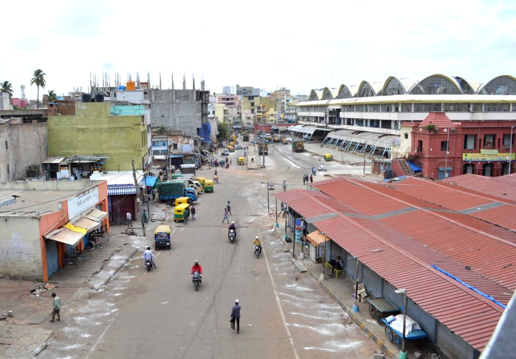 KR Market bars a deserted look during a strict lockdown that has been re-imposed for 15 days in five wards across Bengaluru to contain the spread of COVID-19 and reduce the pandemic cases, ...