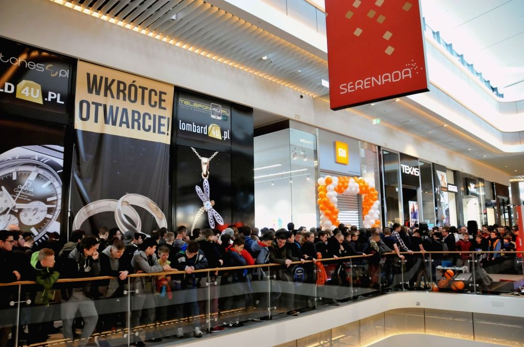 KRAKOW(POLAND), March 25, 2018 Customers wait for the opening of Xiaomi's first authorized store in Krakow, Poland, March 24, 2018. China's innovative technology company Xiaomi opened its ...