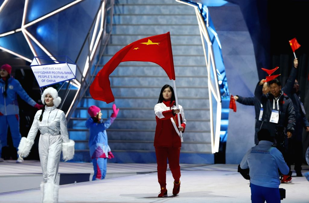 KRASNOYARSK, March 2, 2019 - Yang Shiqi (C), flag bearer of Chinese delegation marches on the stage during the opening ceremony of 29th Winter Universiade in Krasnoyarsk, Russia, March 2, 2019.