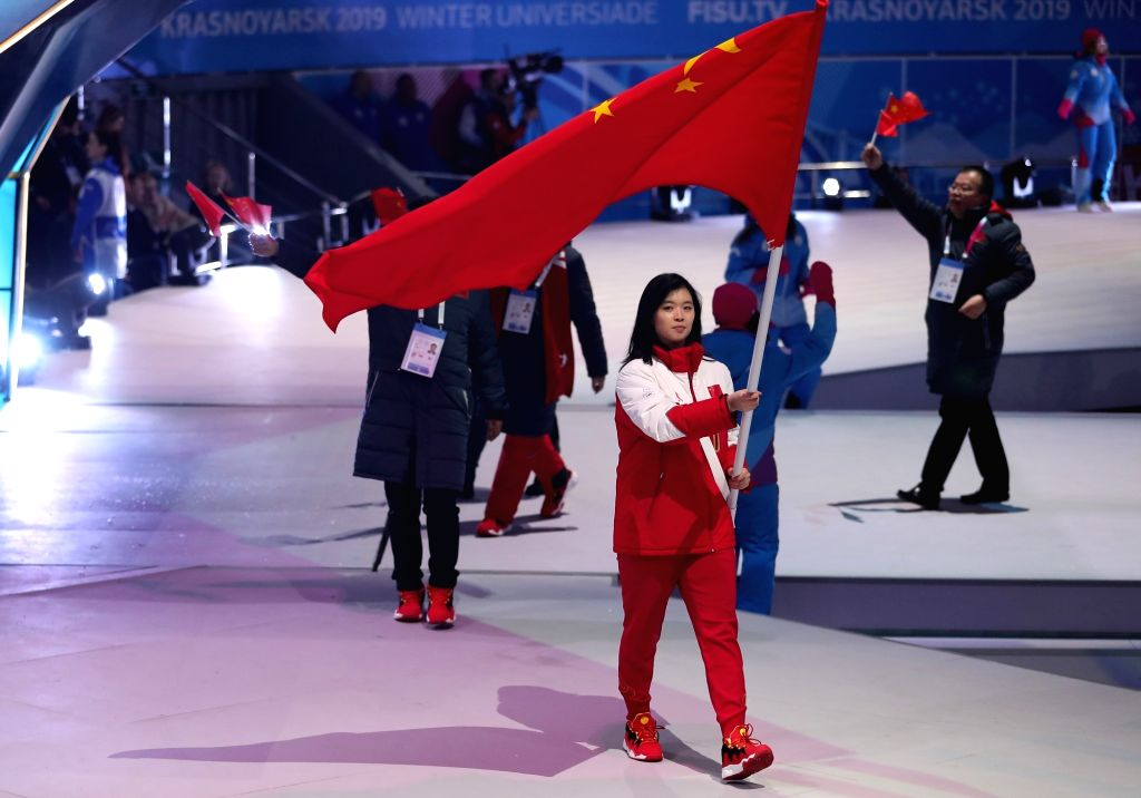KRASNOYARSK, March 2, 2019 - Yang Shiqi (front), flag bearer of Chinese delegation marches on the stage during the opening ceremony of 29th Winter Universiade in Krasnoyarsk, Russia, March 2, 2019.