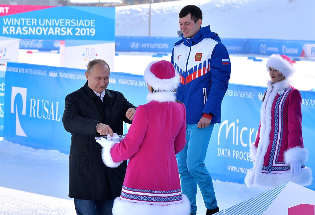 KRASNOYARSK, March 3, 2019 - Russian President Vladimir Putin (1st L) attends the awarding ceremony after the cross country skiing men's 10km individual at the 29th Winter Universiade in Krasnoyarsk, ...