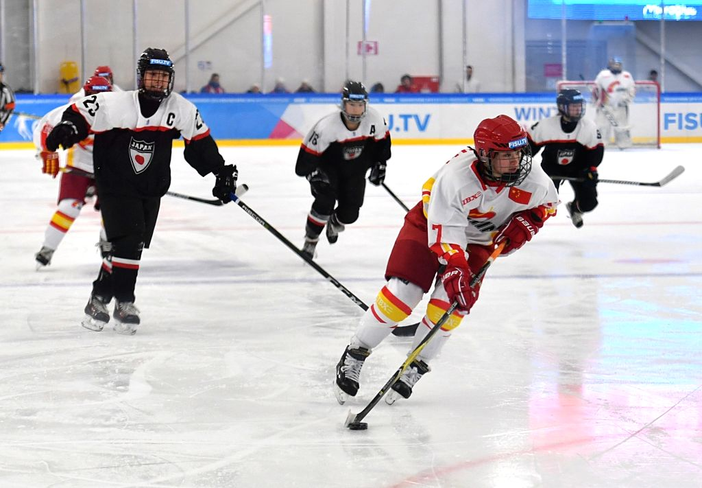 KRASNOYARSK, March 6, 2019 - Lu Shuang (front) of China competes during the women's ice hockey preliminary round group A match between China and Japan at the 29th Winter Universiade in Krasnoyarsk, ...