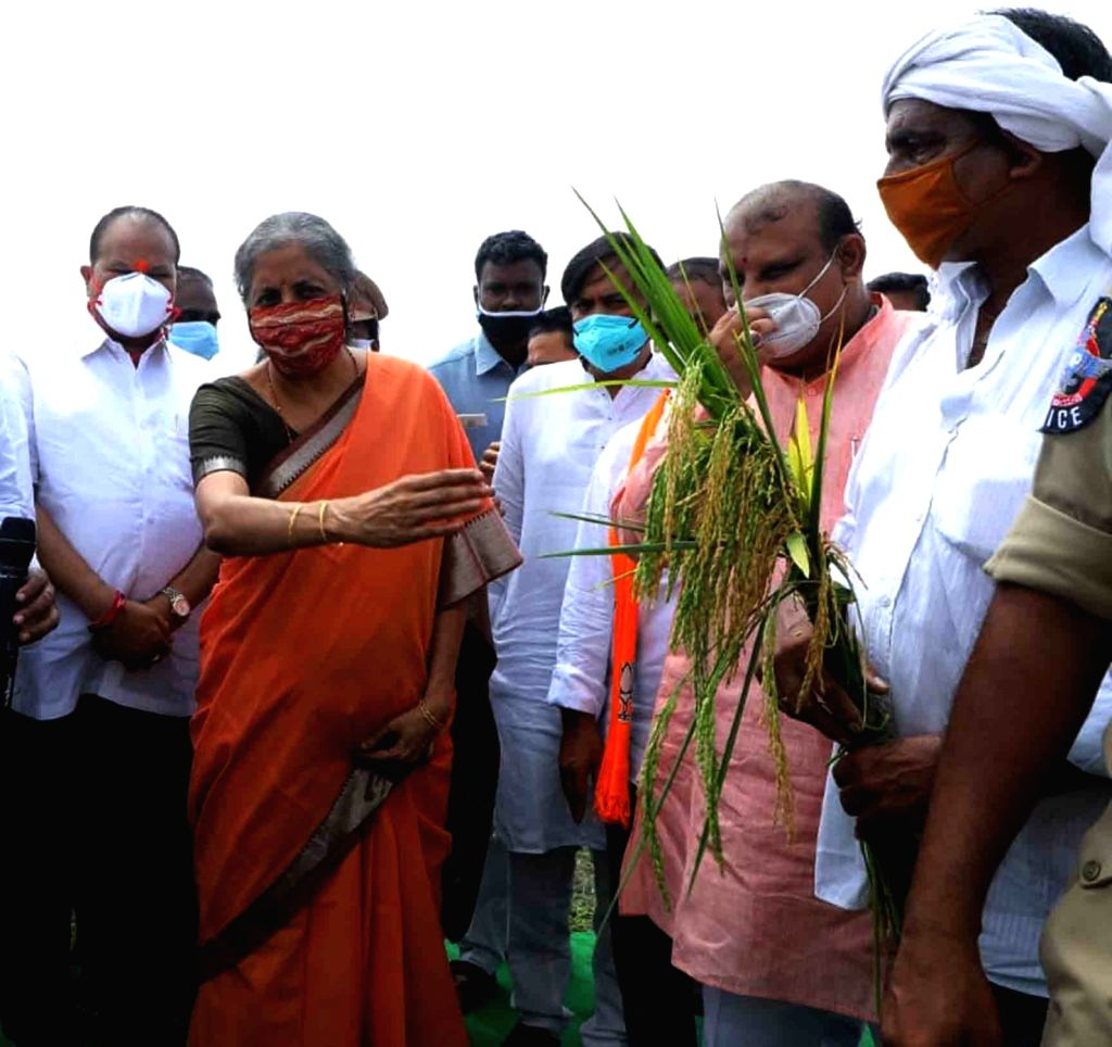 Krishna: Union Finance and Corporate Affairs Minister Nirmala Sitharaman made a brief visit to a farm in Jakkula Nekkalam village in Krishna district of Andhra Pradesh while on her way to Vijayawada and interacted with the local farmers, on Oct 7, 20 - Nirmala Sitharaman
