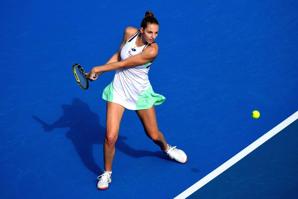 Kristyna Pliskova of the Czech Republic returns a shot during the women's singles semifinal match against Elena Rybakina of Kazakhstan at WTA Shenzhen Open tennis ...