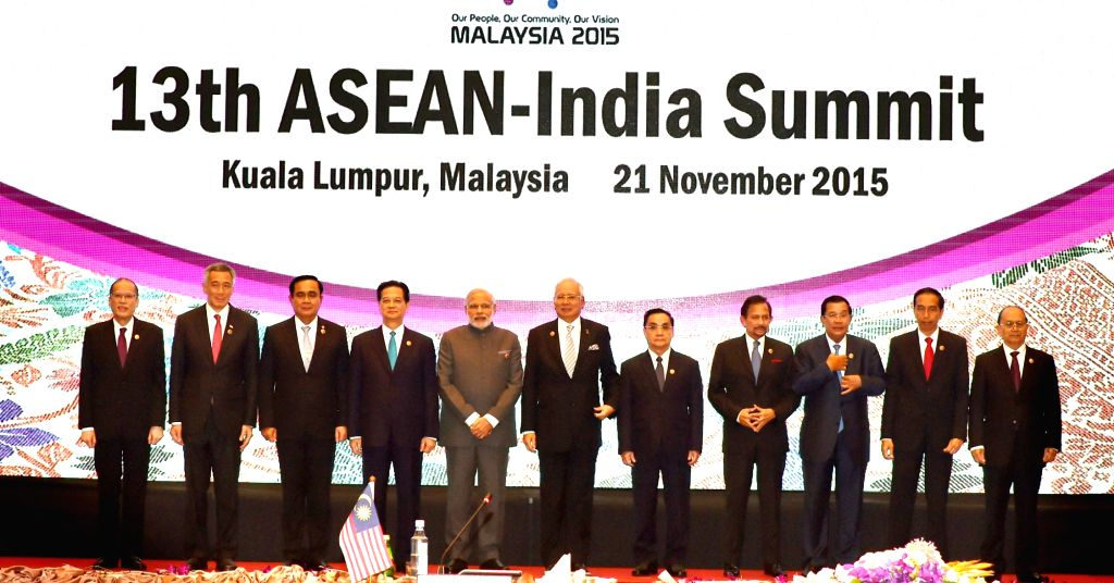 Kuala Lampur: Prime Minister Narendra Modi with other leaders in the family photo during the 13th ASEAN-India Summit, in Kuala Lampur, Malaysia on Nov 21, 2015. - Narendra Modi
