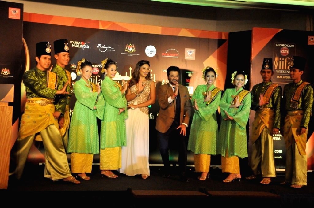 Kuala Lumpur:  Actors Bipasha Basu and Anil Kapoor during a press conference regarding IIFA Awards Malaysia 2015 in Kuala Lumpur. - Bipasha Basu and Anil Kapoor