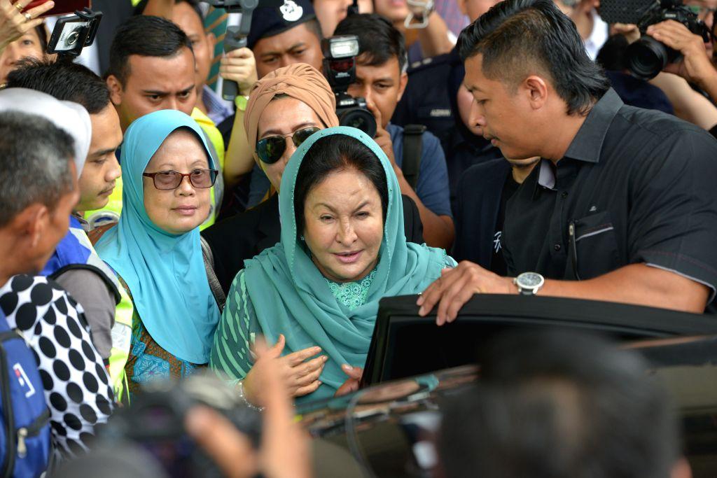 KUALA LUMPUR, April 10, 2019 - Rosmah Mansor (C), the wife of former Malaysian Prime Minister Najib Razak, leaves the court in Kuala Lumpur, Malaysia, April 10, 2019. Rosmah Mansor was charged on ... - Najib Razak