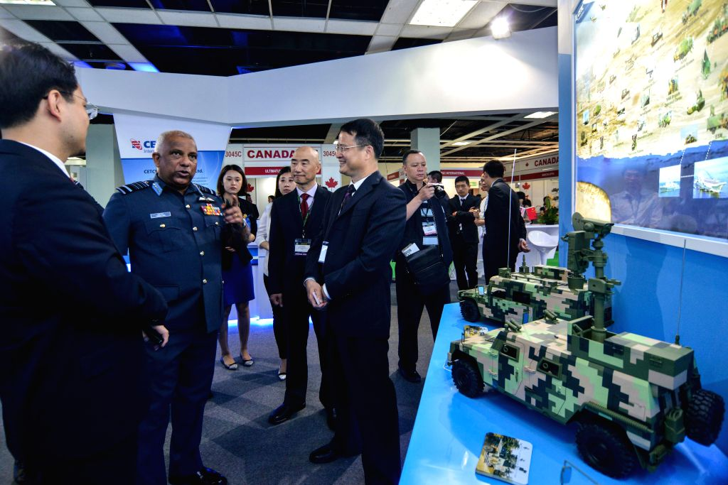 KUALA LUMPUR, April 18, 2016 - Deputies of Chinese defense companies introduce Chinese military equipment to visitors at the 2016 Defence Services Asia (DSA) exhibition in Kuala Lumpur, capital of ...