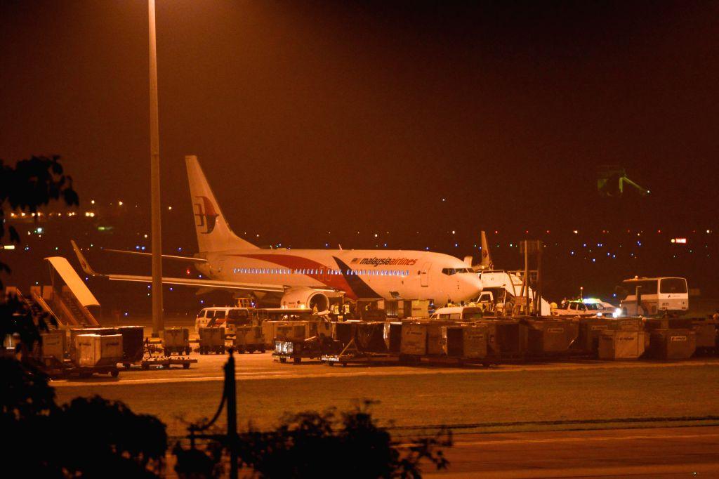 KUALA LUMPUR, April 21, 2014 (Xinhua) -- Malaysia Airlines flight MH192 from Kuala Lumpur to Bangalore is seen at Kuala Lumpur International Airport in Malaysia on April 21, 2014. Malaysian Minister of Transportation Hishammuddin Hussein met with pas