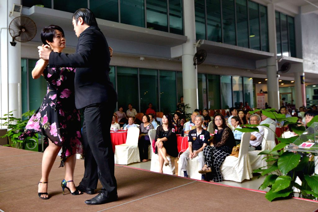 KUALA LUMPUR, April 22, 2017 - A dancer (L) suffered with Parkinson's disease dances with her parterner during an event to promote awareness of Parkinson's disease in Kuala Lumpur, Malaysia, on April ...