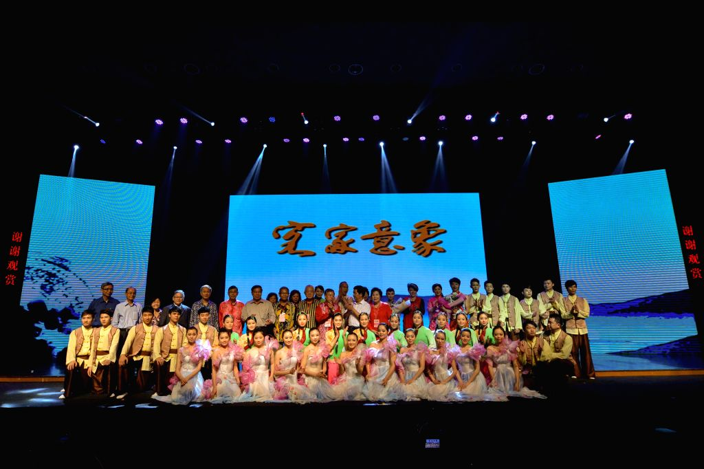 Actors and guests pose for photos after the singing and dancing show Hakka Image in Kuala Lumpur, capital of Malaysia, on April 26, 2014. To celebrate the ...