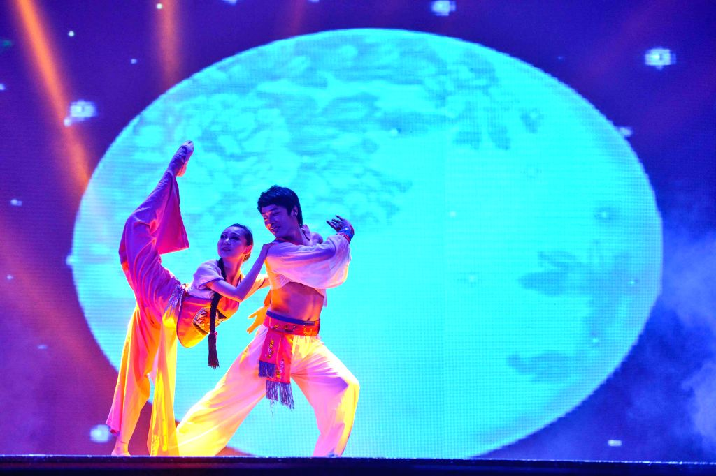 An actor and an actress perform during the singing and dancing show Hakka Image in Kuala Lumpur, capital of Malaysia, on April 26, 2014. To celebrate the ...