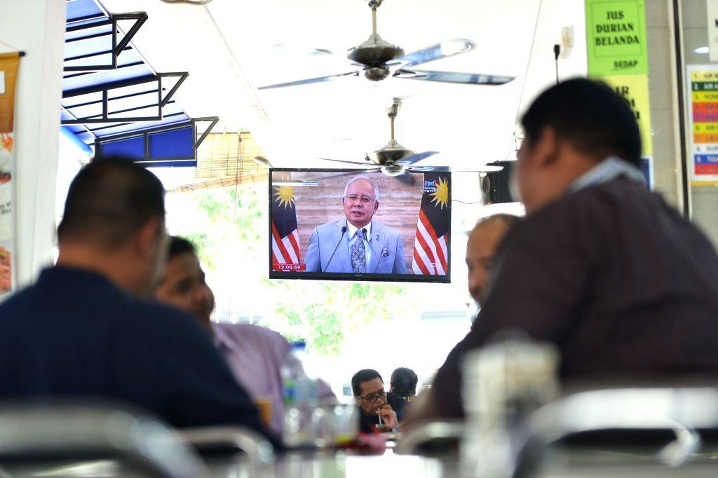 KUALA LUMPUR, April 6, 2018 - A television shows Malaysian Prime Minister Najib Razak's live speech at a restaurant in Putrajaya, Malaysia on April 6, 2018. Malaysian Prime Minister Najib Razak said ... - Najib Raza