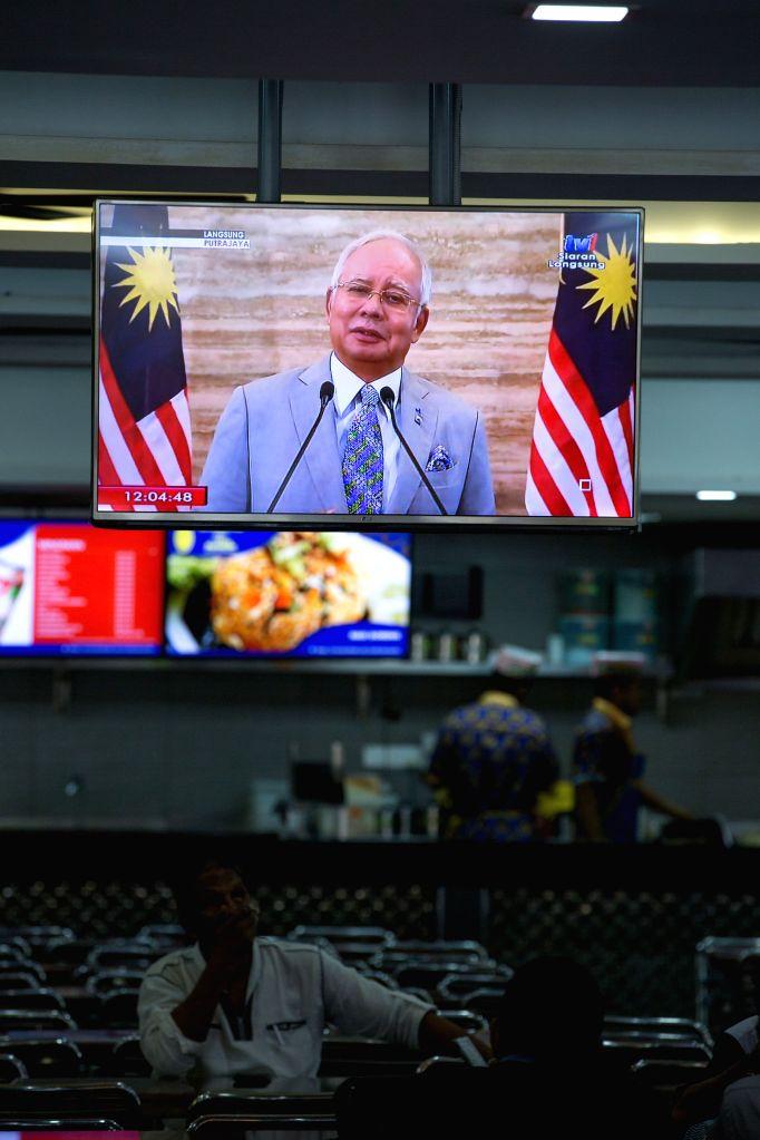 KUALA LUMPUR, April 6, 2018 - A television shows Malaysian Prime Minister Najib Razak's live speech at restaurant in Kuala Lumpur, Malaysia on April 6, 2018. Malaysian Prime Minister Najib Razak said ... - Najib Raza