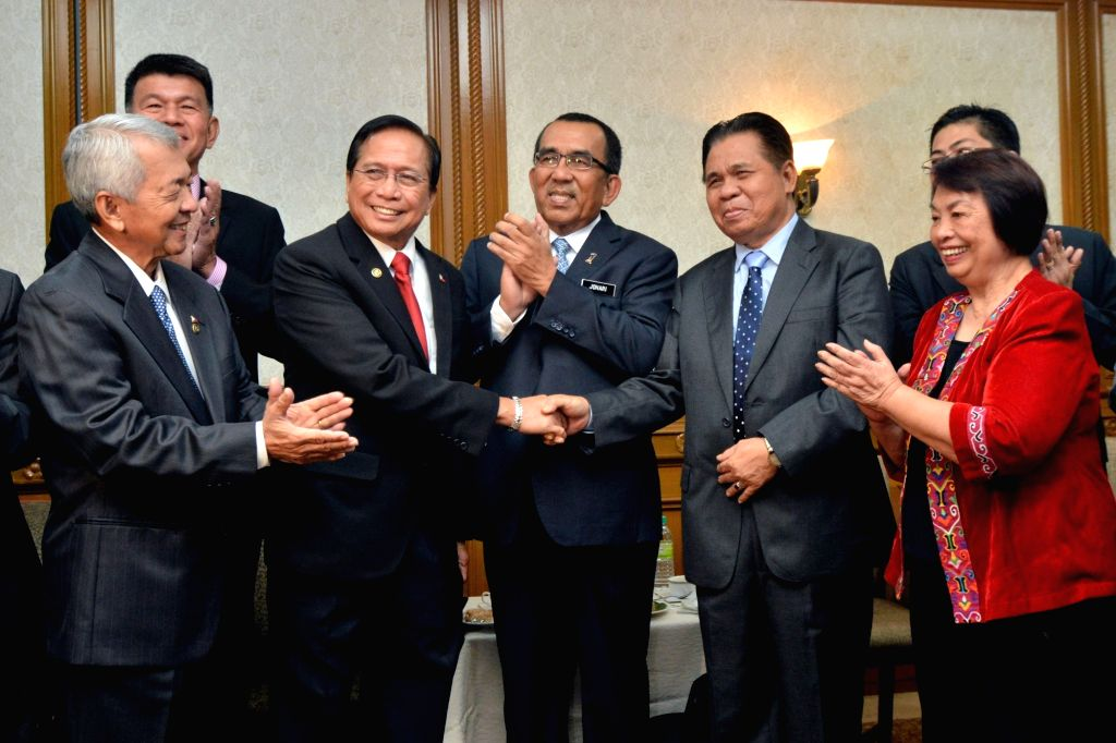 KUALA LUMPUR, Aug. 13, 2016 - Philippine presidential adviser on the peace process Jesus Dureza (2nd L, front) shakes hands with Murad Ebrahim (2nd R, front), Chairman of Moro Islamic Liberation ...