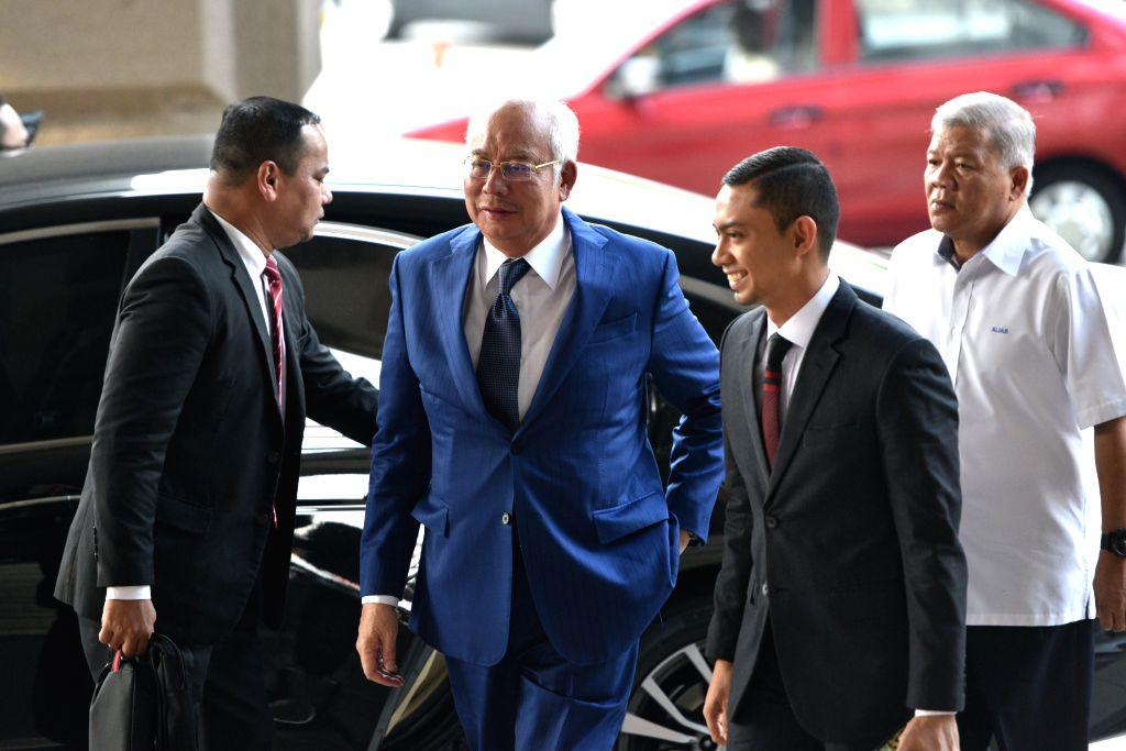 KUALA LUMPUR, Aug. 27, 2019 - Former Malaysian Prime Minister Najib Razak (2nd L) arrives at a court in Kuala Lumpur, Malaysia, Aug. 27, 2019. The prosecution wrapped up its submission on Tuesday ... - Najib Razak