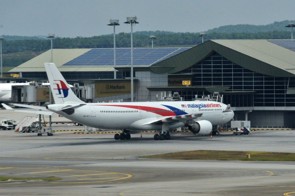 A Malaysia Airlines flight is seen parking at the Kuala Lumpur International Airport in Kuala Lumpur, Malaysia, Aug. 8, 2014. Khazanah Nasional Bhd, Malaysia ...