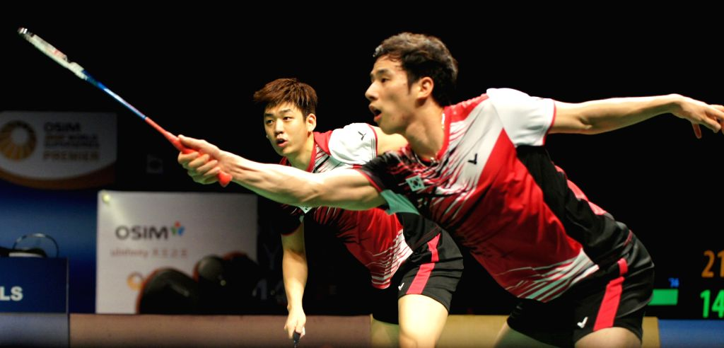South Korea's Ko Sung Hyun (R) and Lee Yong Dae compete during the men's doubles semi-final badminton match with compatriots Kim Ki Jung/Kim Sa .