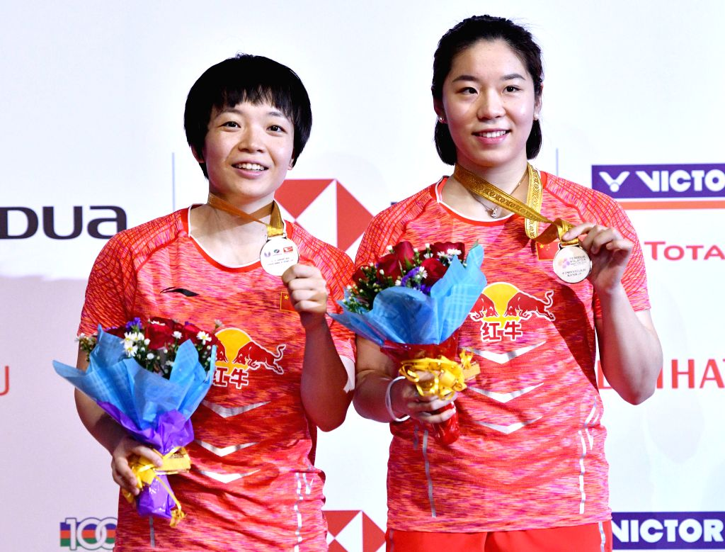 KUALA LUMPUR, Jan. 21, 2018 - Chen Qingchen (L) and Jia Yifan of China pose during the awarding ceremony after the women's doubles final match against Kamilla Rytter Juhl and Christinna Pedersen of ...
