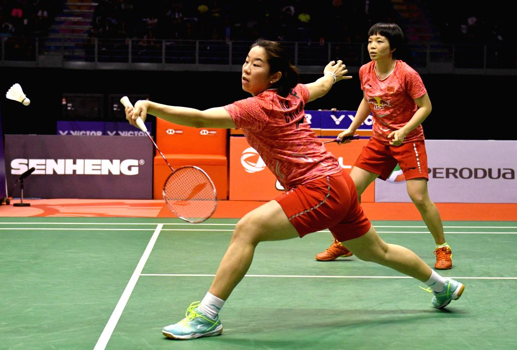 KUALA LUMPUR, Jan. 21, 2018 - Chen Qingchen (R) and Jia Yifan of China compete during the women's doubles final match against Kamilla Rytter Juhl and Christinna Pedersen of Denmark at Malaysia ...