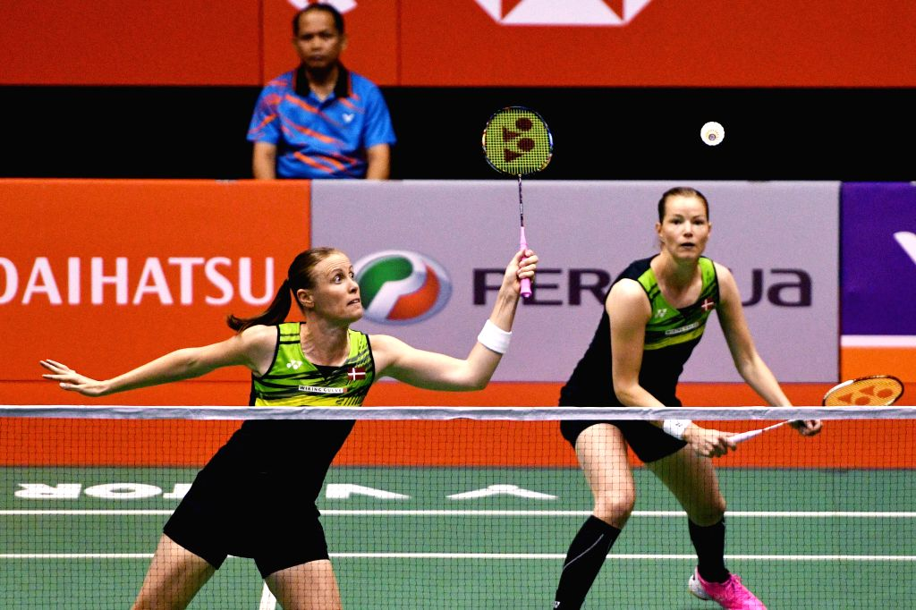 KUALA LUMPUR, Jan. 21, 2018 - Kamilla Rytter Juhl (L) and Christinna Pedersen of Denmark compete during the women's doubles final match against Chen Qingchen and Jia Yifan of China at Malaysia ...