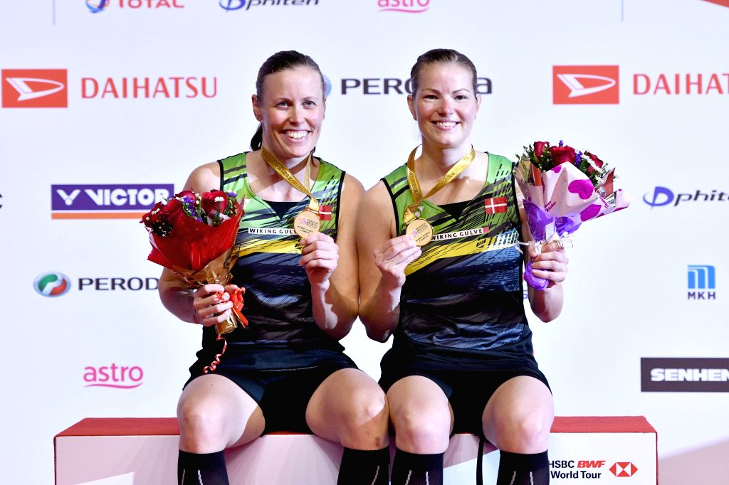 KUALA LUMPUR, Jan. 21, 2018 - Kamilla Rytter Juhl (L) and Christinna Pedersen of Denmark pose during the awarding ceremony after the women's doubles final match against Chen Qingchen and Jia Yifan of ...