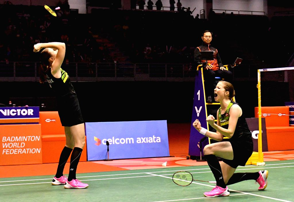 KUALA LUMPUR, Jan. 21, 2018 - Kamilla Rytter Juhl (L) and Christinna Pedersen of Denmark celebrate after the women's doubles final match against Chen Qingchen and Jia Yifan of China at Malaysia ...