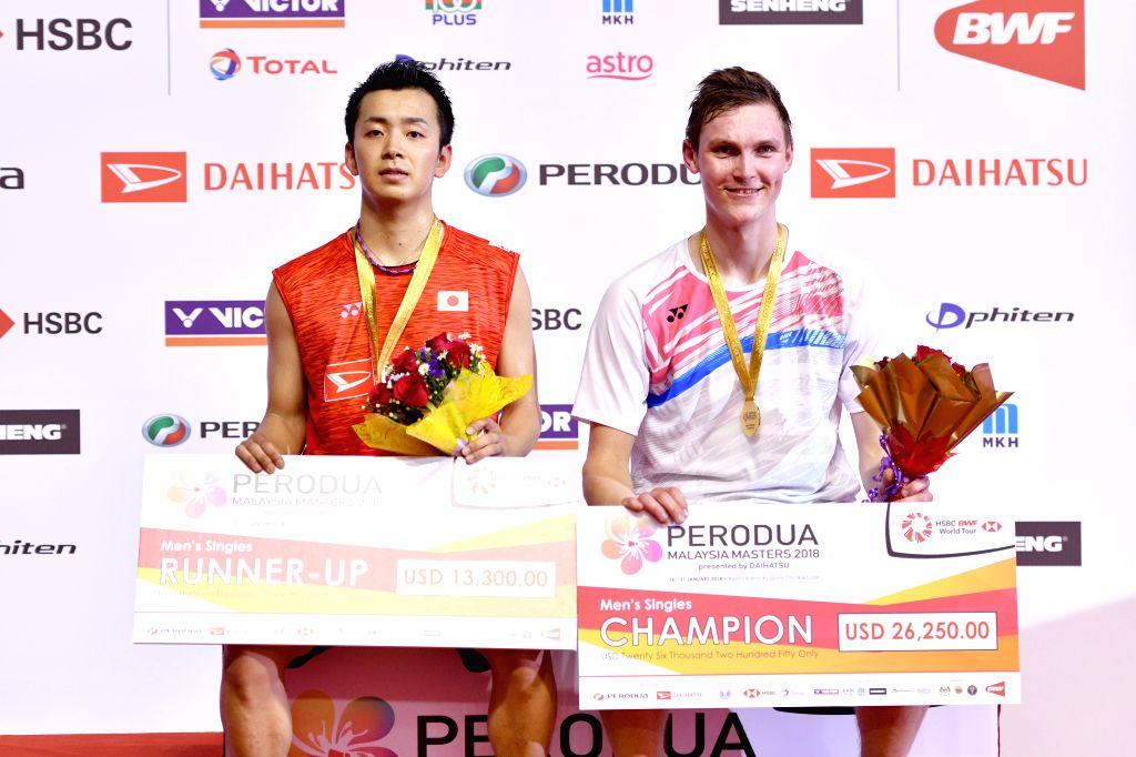 KUALA LUMPUR, Jan. 21, 2018 - Viktor Axelsen of Denmark and Kenta Nishimoto of Japan pose during the awarding ceremony after their men's singles final match at Malaysia Masters 2018 in Kuala Lumpur, ...
