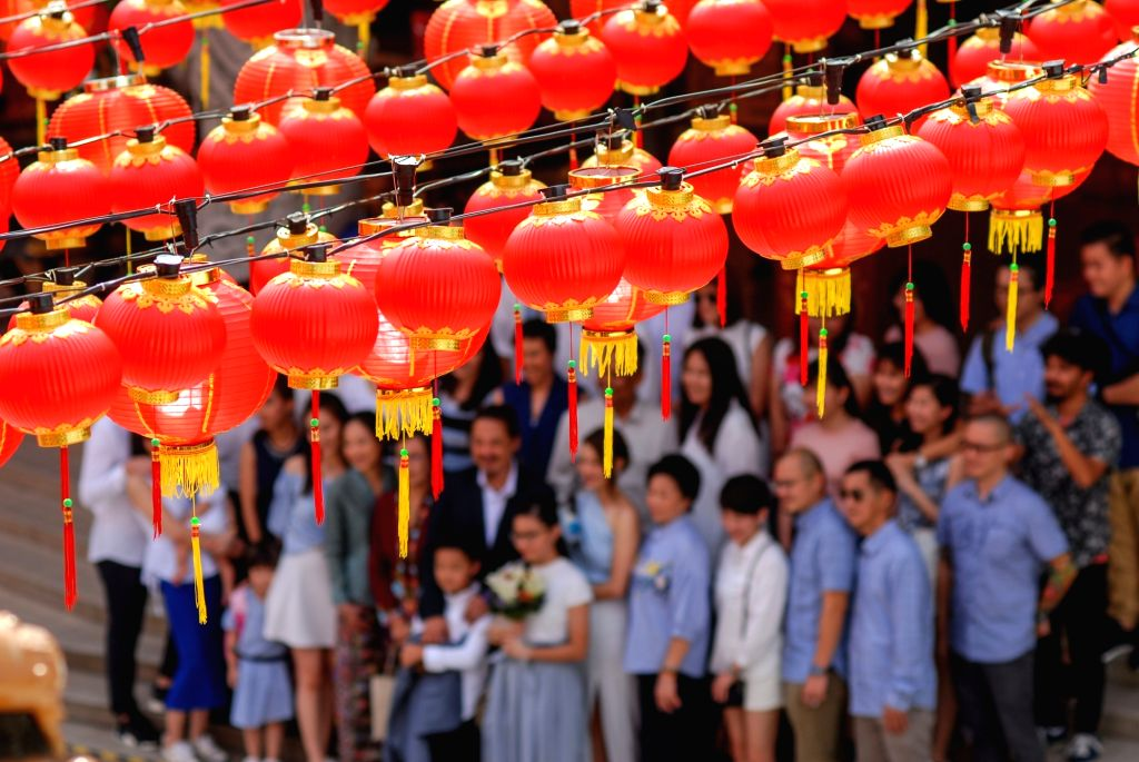 KUALA LUMPUR, Jan. 24, 2018 - Visitors pose for photos under the red lanterns set for Chinese lunar new year, at the Thean Hou Temple in Kuala Lumpur, Malaysia, Jan. 24, 2018.