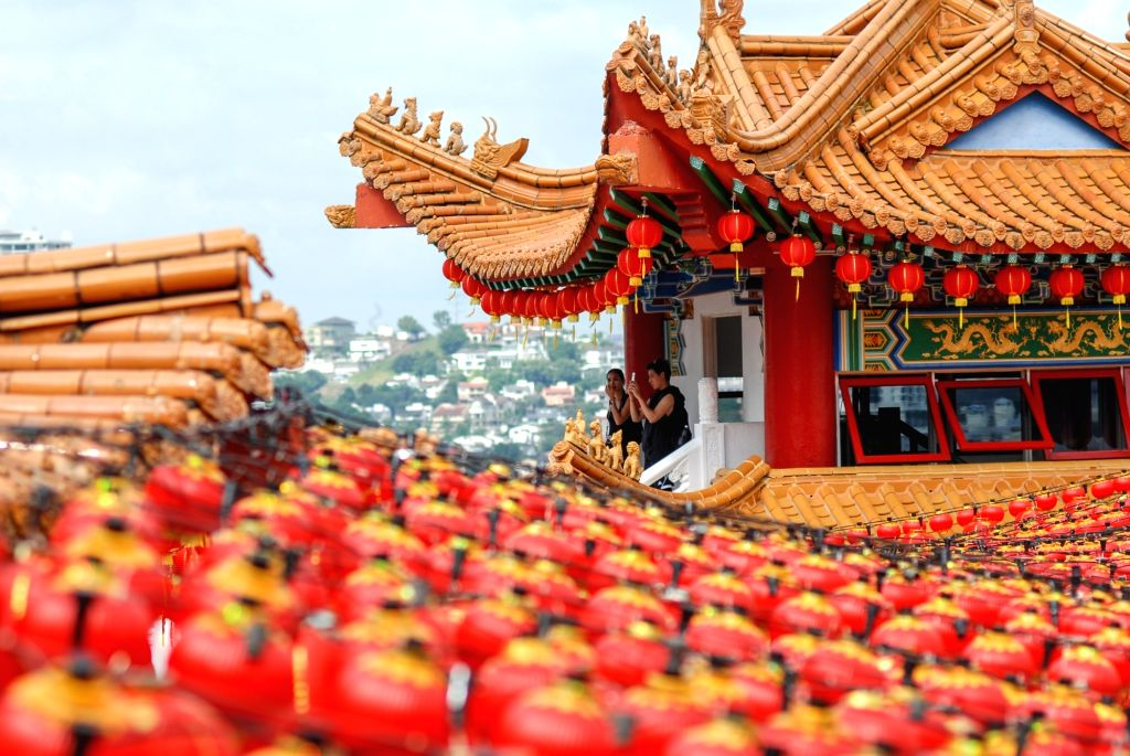 KUALA LUMPUR, Jan. 24, 2018 - Visitors take photos in front of the red lanterns set for Chinese lunar new year, at the Thean Hou Temple in Kuala Lumpur, Malaysia, Jan. 24, 2018.
