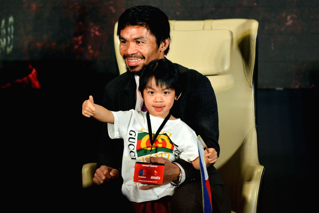 KUALA LUMPUR, July 12, 2018 - Boxing legend Manny Pacquiao and his son Israel Paquiao attend a pre-match press conference in Kuala Lumpur, Malaysia, July 12, 2018. The highly anticipated fight ...