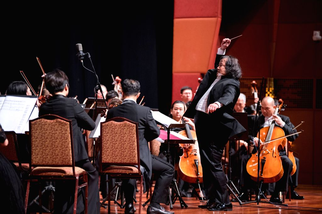 """KUALA LUMPUR, July 16, 2019 - Conductor Tang Muhai (R, front) conducts the Guangxi Symphony Orchestra during the """"Maritime Silk Road Legend Concert 2019"""" in Kuala Lumpur, Malaysia, July 16, ..."""