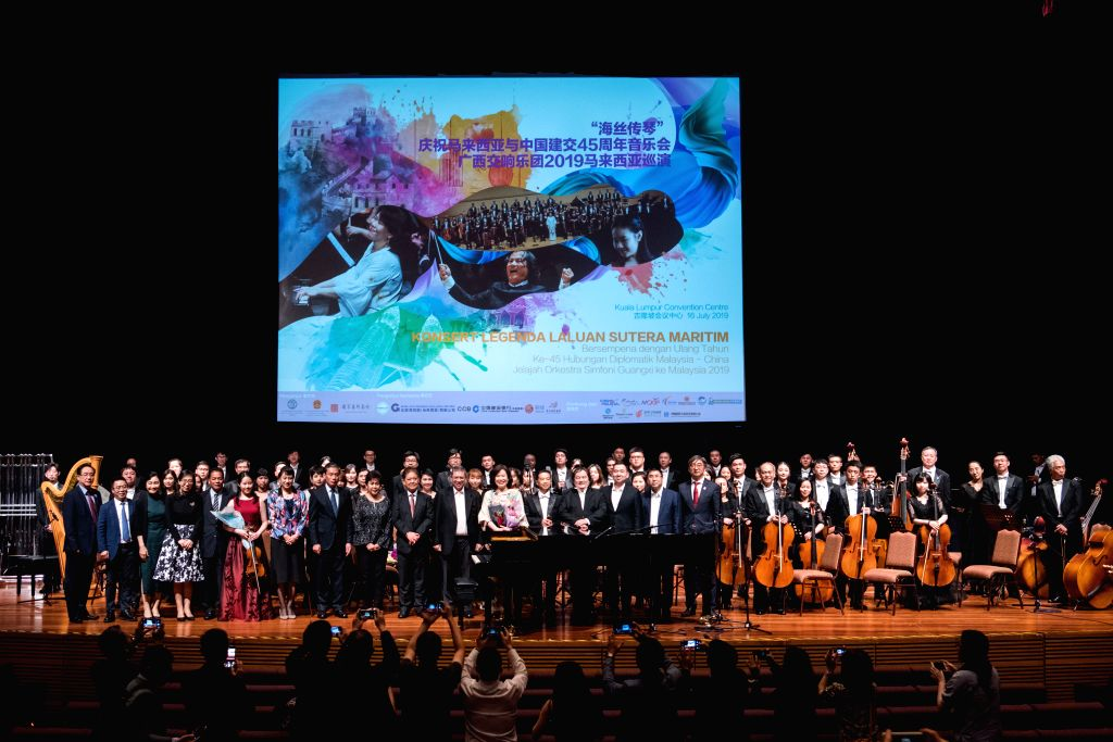 """KUALA LUMPUR, July 16, 2019 - Guests pose for photos with Chinese and Malaysian musicans after the """"Maritime Silk Road Legend Concert 2019"""" in Kuala Lumpur, Malaysia, July 16, 2019. ..."""