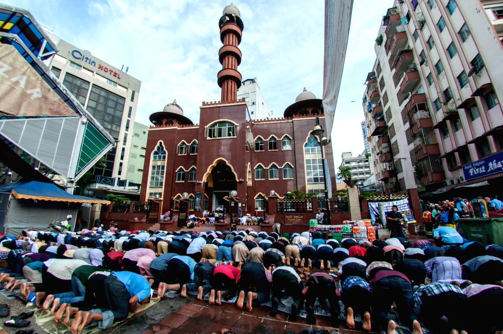 KUALA LUMPUR, June 25, 2017 - People attend a prayer in celebration of the Eid al-Fitr in Kuala Lumpur, Malaysia, June 25, 2017. Muslims around the world celebrated the Eid al-Fitr festival, which ...